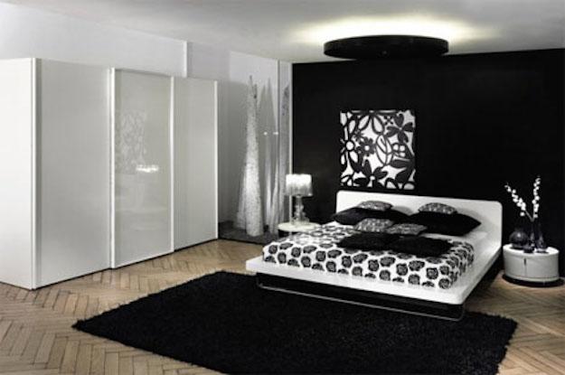 Habitacion-con-paredes-negras-y-muebles-blancos